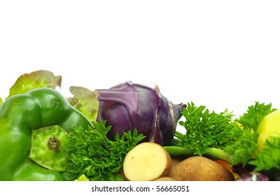 Fresh fruits and vegetables on pure white background