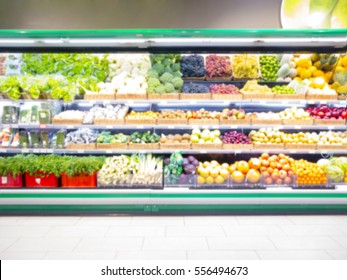 Fresh fruits and vegetables on shelf in supermarket. Blur