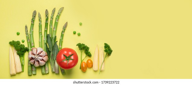Fresh fruits and vegetables on yellow background. Healty food concept. Vegan and vegetarian diet eating. Foods high in vitamins and antioxidants. Top view, panorama, banner with copy space