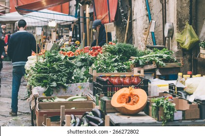 Fresh fruits and vegetables for sale in Ballaro, famous market in Palermo, Sicily island, Italy. Toned image