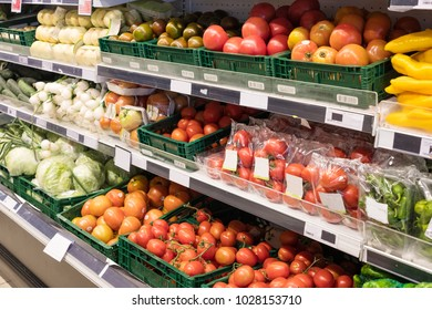 Fresh fruits and vegetables in supermarket. Market interior