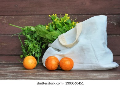 Fresh Fruits and Vegetables in a tote bag on a  wooden table Background.Use tote bag for Replacement plastic bag can save the earth.Zero Waste, Healthy Eating, Package Free,Green Living concept.