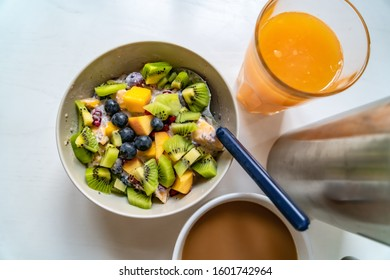 Fresh fruitsalad with orange juice and coffee. Healthy breakfast.