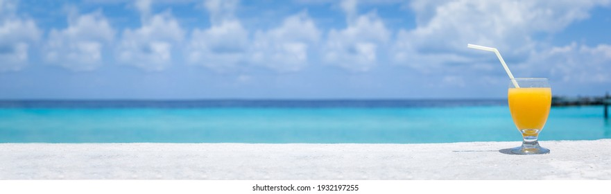 Fresh fruity welcome drink on tropical vacation with sea background. Long banner