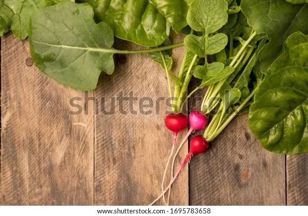 Fresh garden greens on rustic wood table flat lay healthy