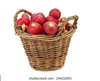 Fresh garden radish in basket on a white background
