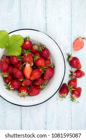 Fresh garden strawberries. Old bowl with strawberries on white