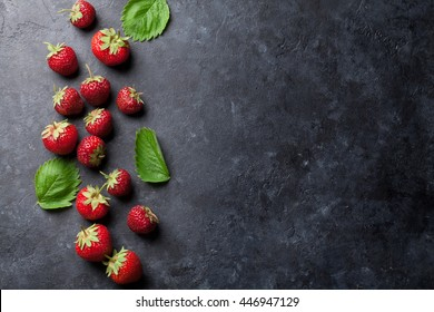 Fresh garden strawberry on stone table. Top view with copy space