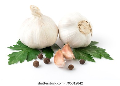 Fresh garlic with black pepper and parsley  isolated on white background. Raw garlic