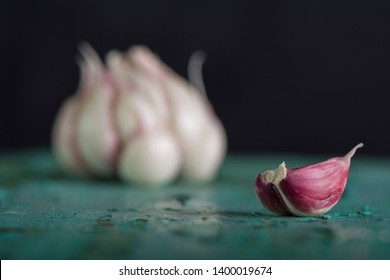 Fresh garlic bulbs on turquoise wooden kitchen table, healthy everyday eathing background