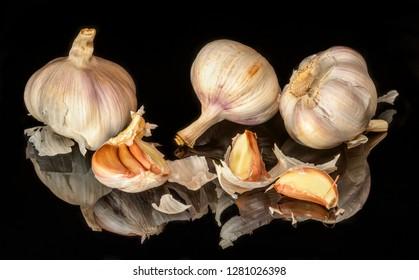 Fresh garlic on black background