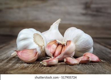 Fresh garlic on a wooden background.