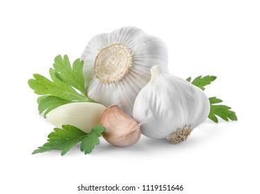 Fresh garlic and parsley on white background