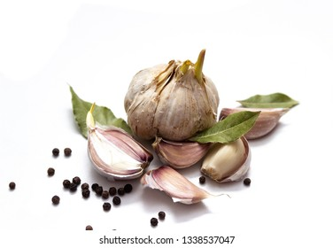 Fresh garlic  and pepper on white  board, isolated on white background.