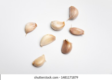 Fresh garlic is ready to be used for cooking. on the White Background