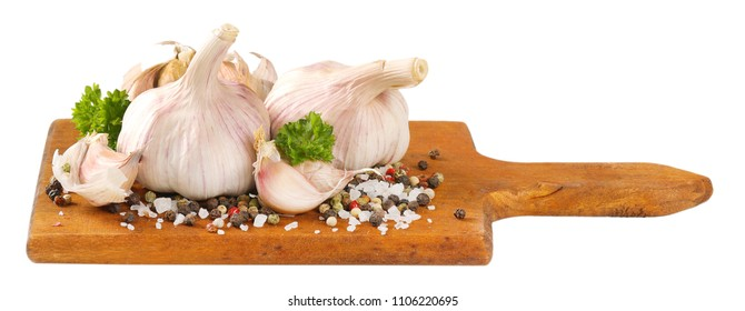 fresh garlic with spices on wooden cutting board
