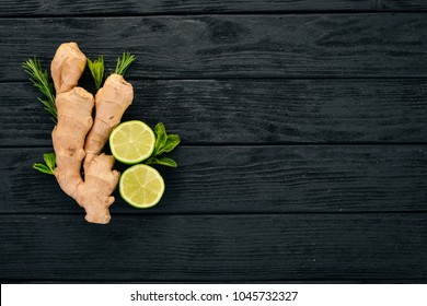 Fresh ginger, lemon and lime on a wooden background. Top view. Copy space.
