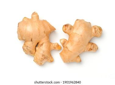 Fresh ginger on white background. top viwe