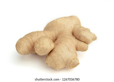 Fresh Ginger root isolated on white background.  Close-up of fresh whole Ginger Root isolated on white Background.