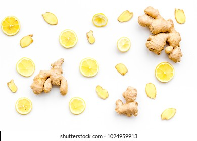Fresh ginger root and lemon slices pattern on white background top view
