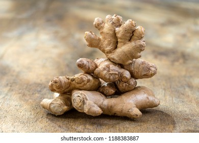 Fresh ginger root on the wooden background enlightened