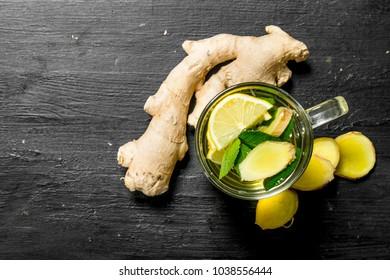 Fresh ginger tea with lemon. On the black chalkboard.