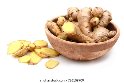 Fresh ginger and wooden bowl isolated
