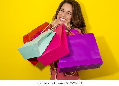 fresh Girl enjoy shopping on yellow background
