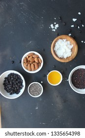 fresh gluten-free oatmeal ingredients with nuts chia seeds and honey