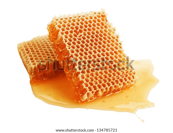 fresh golden honeycomb isolated on white background