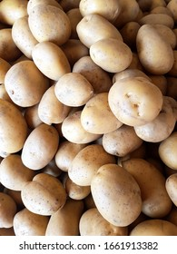 Fresh golden, yellow potatoes in farmer's market. food background.