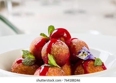 fresh gourmet donut balls desert in white bowl