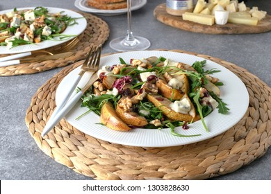 Fresh gourmet salad Pear, gorgonzola cheese, arugula, walnuts, cheese platter - Healthy eating concept, served food, romantic dinner