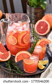 Fresh grapefruit cocktail. Fresh summer cocktail with grapefruit, lime, sprig of rosemary and ice cubes.
