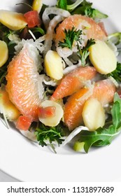 Fresh grapefruit salad with potatoes and celery