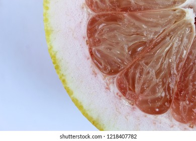 Fresh grapefruit ( Shaddock, pomelo,Pummelo, Citrus maxima or Citrus grandis) isolated on a white background cutout close up. copy space.Tasty Indian tropical fruit.Healthy food for slow down aging.
