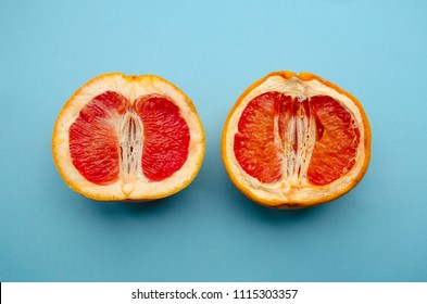 Fresh grapefruit and stale grapefruit on a blue background. Concept of female health. A healthy vagina and an unhealthy vagina.