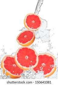 Fresh grapefruits falling in water splash, isolated on white background