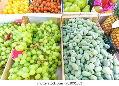 Fresh grapes, figs, lemons, tomatoes, pears and pineapples for sale in local marketplace