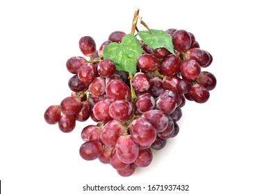Fresh grapes have leaves placed on a white background.