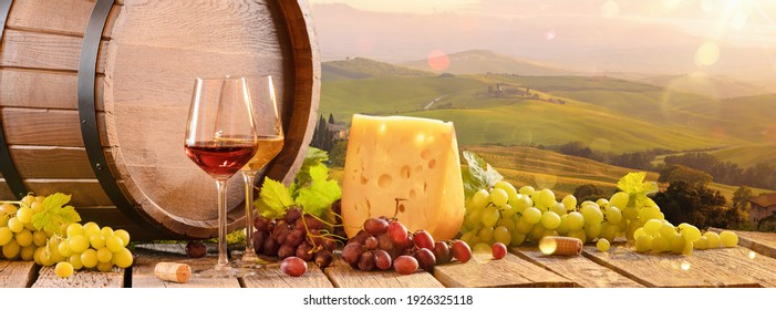 Fresh Grapes And Wine With Cheese On The Background Of An Italian Landscape. Tuscany Region