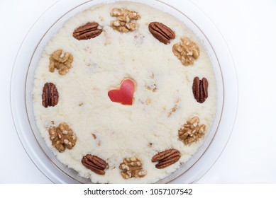 fresh grated celery salad waldorf, garnished with walnuts, pecan and apple heart