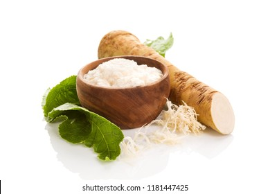 Fresh grated horseradish root and leaves isolated on white background. Homemade wassabi.