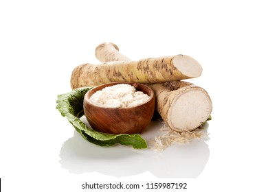 Fresh and grated horseradish roots isolated on white background.