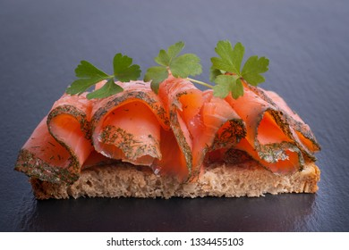 Fresh graved salmon on a slate
