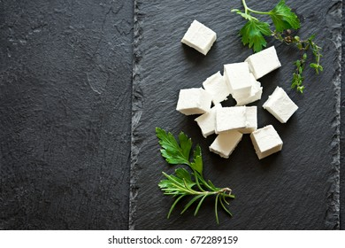 Fresh Greek Feta Cheese. Healthy ingredient for cooking salad. Goat feta cheese with herbs.
