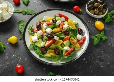 Fresh Greek salad with cucumber, cherry tomato, lettuce, red onion, feta cheese and black olives. Healthy food