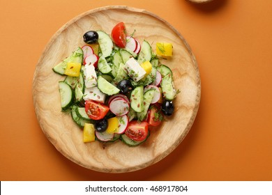 Fresh Greek salad with feta and olives, food top view