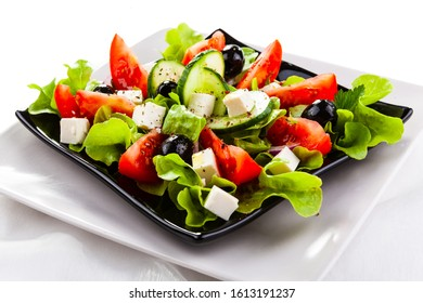 Fresh greek salad on white background