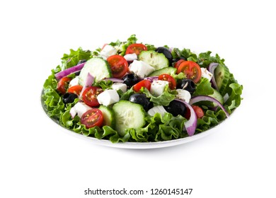 Fresh Greek salad in Plate with black olive,tomato,feta cheese, cucumber and onion isolated on white background